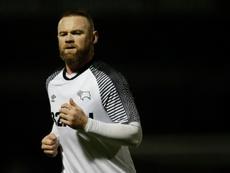 Wayne Rooney, crítico ao lidar com a pandemia do COVID-19. AFP