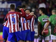 Les joueurs de l'Atletico Madrid se congratulent après un but contre Guijuelo (D3). AFP