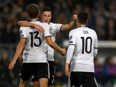 Muller, Ozil and Draxler celebrating a goal. AFP
