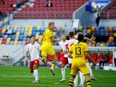 Haaland gave Dortmund a last gasp victory at Dusseldorf. AFP