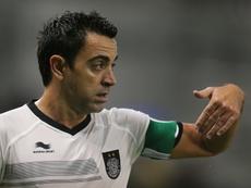 Xavi acaricia su título número 35 en su penúltimo partido. AFP