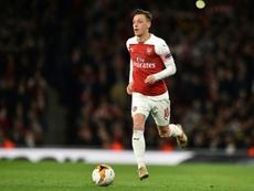 Ozil ne veut pas quitter Arsenal. AFP