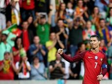Capitão português já está na Cidade do Futebol. AFP