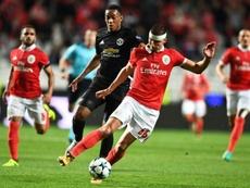 Ruben Dias (d) estaría en el punto de mira del Tottenham de cara al próximo verano. AFP/Archivo