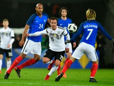 Gotze vies with Steven Nzonzi and Antione Griezman. AFP