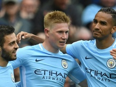 De Bruyne is hopeful of returning in time to face City's bitter rivals. AFP