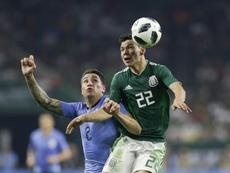 El mexicano se estrenará en Champions en el Camp Nou. AFP
