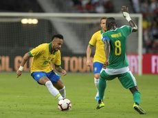 Neymar (L) enjoyed his 100th game for Brazil, but he could not score. AFP