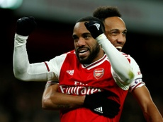 Arsenal are working to get Aubameyang to renew his contract. AFP