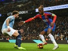 Zaha tiene contrato con el Crystal Palace hasta 2023. AFP