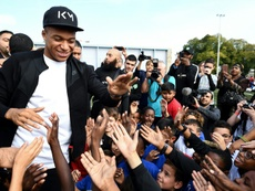 Mbappe was welcomed back to hometown Bondy. AFP