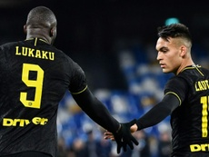Lautaro Martinez (R) is not interested in talk of him going to Barca. AFP