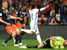 Lacazette marcou dois gols contra o Montpellier. AFP