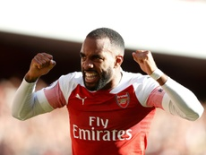 Lacazette was about to sign for Aletico when he still played in France. AFP
