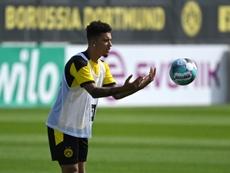 Sancho parece não pensar mais no United. AFP