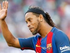 Maxi López recordó cuando compartió equipo con Ronaldinho. AFP