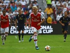 Özil de retour dans le groupe d'Arsenal contre Liverpool. AFP