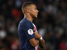 Varane defende Mbappé. AFP