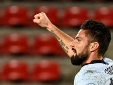 AC Milan are considering buying Giroud in January. AFP
