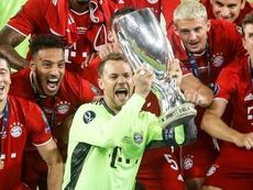 Neuer se tornou um dos melhores goleiros de todos os tempos. AFP