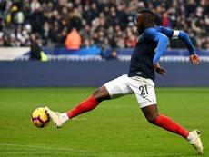 Ndombélé intéresse United. AFP