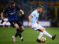 Skriniar (l) has received interest from Real Madrid and Barcelona. AFP