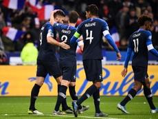No aperto, campeões do mundo vencem a valente Moldávia. AFP
