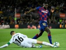 Umtiti reaccionó tras confirmar el Barça su lesión. AFP