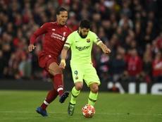 O que une Luis Suárez, Virgil van Dijk e Koeman? AFP