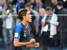 Varane completed a historic double. AFP