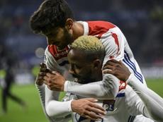 Moussa Dembélé celebrates scoring with Hassem Aouar. AFP