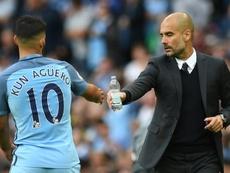 Guardiola se refirió al futuro del 'Kun' en Mánchester. AFP