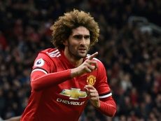 Fellaini wans to close the gap. AFP