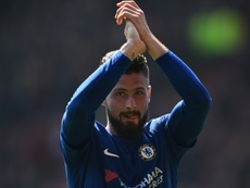 Giroud believes Chelsea will fight to the very end. AFP