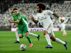 Marcelo (R) expressed his disappointment after RM's late fightback was not enough. EFE