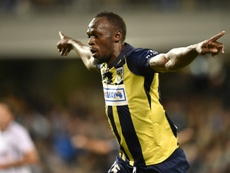 Bolt celebrates scoring for Central Coast Mariners in October. AFP