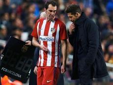 Godín y Simeone hablaron antes de la eliminatoria. EFE