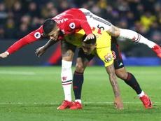 Los hinchas del United, contra Romero y Rojo. EFE/Archivo