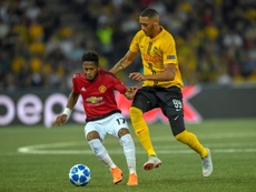 Manchester United midfielder Fred vies with Wolves defender Ryan Bennett