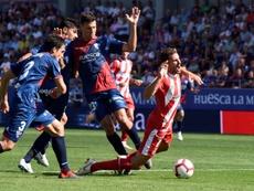 El Huesca consiguió su primer punto en casa. EFE