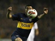 Riquelme brilhou no Boca, mas também jogou com astros no Barcelona. EFE/Javier Garcia Martino