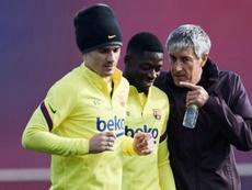 Griezmann et Dembélé, de retour à l'entraînement avec le Barça. EFE