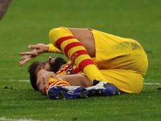 Piqué tem uma grave entorse de ligamentos. EFE / Juanjo Martín