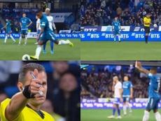 Malcom acerta uma bolada no árbitro e escapa do amarelo. Captura/Zenit