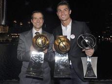 Cristiano Ronaldo e seu representante, Jorge Mendes. AFP