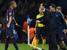 Mbappe doesn't believe Emery was completely to blame. AFP