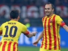 Iniesta não escondeu a admiração que sente por Messi. AFP
