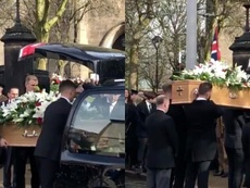 The coffin is carried into the Stoke-on Trent church.