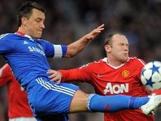 John Terry y Wayne Rooney. AFP