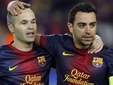 Xavi e Iniesta, modelos del ADN de Vilà en la cantera del Barça. EFE